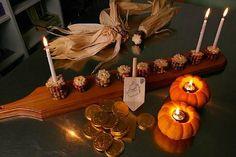 Celebrate Thanksgivukkah the DIY way. A corn menorah, pumpkin olive oil lamps and a dessert dreidel make for a festive table.