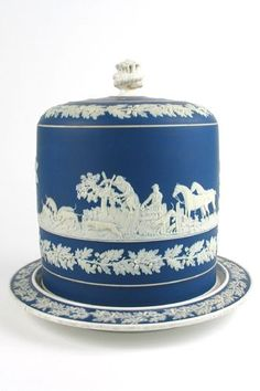 An English Jasperware cake stand of cobalt blue porcelain in the manner of Wedgwood, for a 7-layer cake