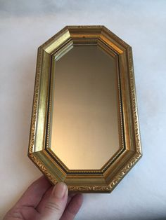 A personal favorite from my Etsy shop https://www.etsy.com/ca/listing/496059901/vintage-gold-mirror-small-ornate-wall