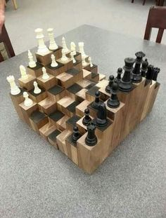 A multiple level chess board. Made of walnut, each block is at a different height to add a fun and artistic factor to the classic game of chess. With a proper workshop and a few pieces of walnut lumber, you can build your own chess board in less[. Woodworking For Kids, Teds Woodworking, Woodworking Crafts, Intarsia Woodworking, Woodworking Machinery, Woodworking Workshop, Woodworking Classes, Woodworking Videos, Woodworking Furniture
