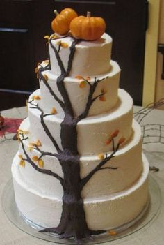 fall themed wedding cake with a tree and pumpkins wedding-cakes