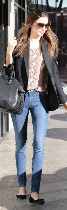 Who made  Miranda Kerr's blue jeans, black ballet flat shoes, snake print tee, and black leather handbag that she wore in West Hollywood on January 21, 2013?
