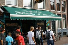 COFFEE HOUSE DIRECTORY: The Greenhouse - This coffee shop has three locations, the flagship located in the Red Light district. It's one of the most famous in Amsterdam and the walls are adorned with photos of celebrities to prove it.