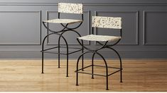 Shop Sling Bar Stools.   Designed by Mermelada Estudio and inspired by a rare vintage seat.  Natural hair-on-hide hand-painted with splatter effect gives this counter stool a one-of-a-kind, just found feel.