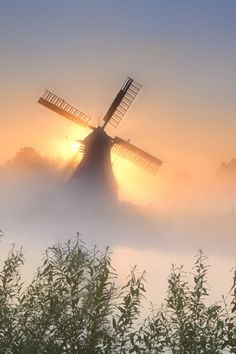 (CP) Misty sunrise behind the windmill near river, Groningen, the Netherlands. Shining by Olha Rohulya on Beautiful Places, Beautiful Pictures, Photos Voyages, Le Moulin, Belle Photo, Mists, Lighthouse, Netherlands, Dutch