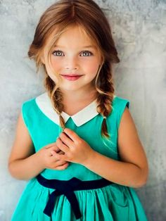 This Dress is adorable with this little girl's hair and eyes!