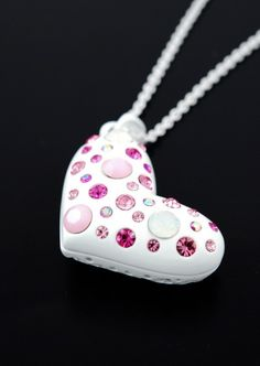 Pink studded heart necklace.  $16.00