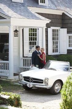 Wouldn't this be a cute post-wedding photo shoot idea?  1960s-style honey-I'm-home kiss on the front porch?