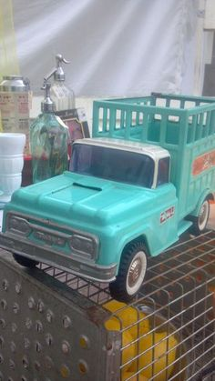 Very cute aqua vintage toy truck. Wish we would have kept daddy's old metal trucks...had one just like this one.