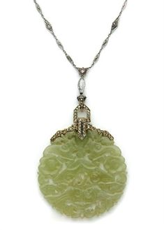 Carved Jade and Diamond Pendant-Necklace  Silver, gold, platinum, one marquise-shaped diamond ap. .40 ct., jade disk ap. 51.0 mm., c. 1920.