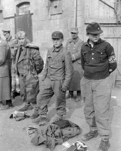 Hitler Youth members pressed into army service are caught by the Americans. Any such youth over 15 was treated as regular soldier for POW purposes. Note the blond guy wearing a winter Waffen SS coat usually issued to officers only. Nagasaki, Hiroshima, Luftwaffe, World History, World War Ii, Fukushima, Man Of War, Ww2 Photos, Total War