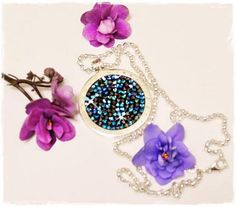 The Blue Rock Crystal coin looks great in a silver pendant! -xx-