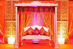 Stage and swing at Hindu Indian Wedding Sangeet in Columbus, Ohio. Table designed by Weddings in Style; wedding planner Kathy Piech-Lukas of Your Dream Day.