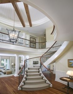 beautiful entry ways inside | Dynamic compound curved stairs highlight this large foyer(via Classic ...