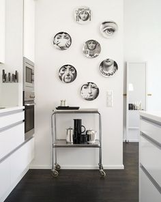 Contemporary Wall Decorating Design. (Remember to put Fornacetti plates on bright wall in kitchen.)