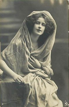 circa 1909. Why did we stop making black and white photos. This one is so beautiful. She has such a serene wishful look on her face.