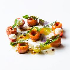 Tomato gnocchi stracciatella Thai basil yellow tomatoes and aged ...