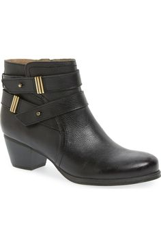 Gold antiqued hardware highlights the dual straps of this burnished leather block-heel bootie that strikes a perfect balance between rugged attitude and sophisticated versatility.