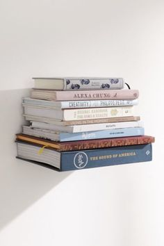 Invisible Book Shelf-- love the idea of decorating with books!