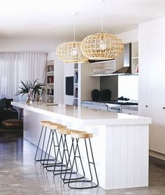 Love the open glass shelves but I'd install bar style hangers. Awesome lights too.