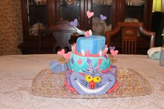 This is my neices's 8th Birthday cake I made.  Alice in Wonderland Inspired.  My first shot at cutting my own angles.  Was a little bumpy but not bad.  I used marshmellow fondant again for everything.  Gum paste for the face and tail.