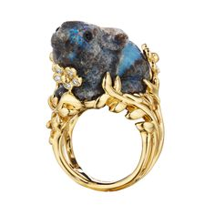 """Mimi So Carved Opal & Diamond Bunny Ring """"Patches"""" carved blue-patch opal bunny ring in 18k yellow gold, depicting a blue, brown, & gray-flecked opal bunny, sitting in a grassy foliate mount with diamond-set flowers. Diamonds weighing 0.28 total carats. Handcrafted in New York City. Designed by Mimi So."""