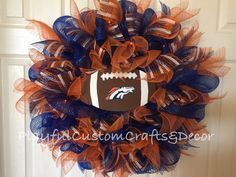 Show off your team spirit with this Denver Broncos Deco Mesh Wreath. This wreath is made on an wire frame using blue deco mesh. Decorated with orange, blue, orange stripe mesh ribbon, orange l Broncos Wreath, Football Wreath, Mesh Ribbon Wreaths, Deco Mesh Wreaths, Burlap Wreaths, Wreath Crafts, Diy Wreath, Wreath Ideas, Sports Wreaths
