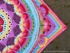 Sophie's Garden Crochet Mandala by Dedri Uys. See other samples on Ravelry and then to Dedri's blog for much more information, here: http://www.lookatwhatimade.net/crafts/yarn/crochet/free-crochet-patterns/sophies-garden-large-crochet-square-photo-tutorial/
