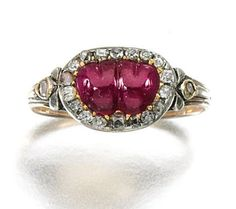 Ruby and diamond ring, Early 19th Century. The two hearts together symbolise marriage and passion. Set at the centre with a ruby carved as two hearts within a border of cushion-shaped and rose diamonds.
