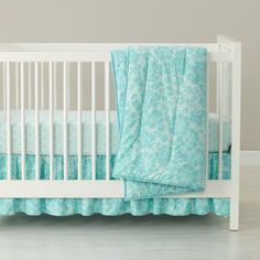 Available in Pink, Lavender, Grey or Aqua, our exclusive Dream Girl Crib Bedding is like something out of a dream (hence the name).  The Crib Quilt features a beautifully printed floral pattern, while the Fitted Sheet is available in Polka Dot or Floral.  The reversible Crib Skirt feature Polka Dots on one side, with a Floral pattern on the other.  Toddler sheets and sham also available.