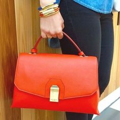 The Sullivan Top Handle Satchel is a little bit proper and a whole lot posh. Crafted with sensuous pebbled leather and equipped with plentiful storage options, this luxury handbag is finished with gleaming Bendel hardware and feet.