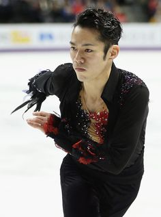 Daisuke Takahashi Photos Photos - Daisuke Takahashi of Japan competes in the Mens Free Skating during the 2013 ISU World Figure Skating Championships at Budweiser Gardens on March 15, 2013 in London, Canada. - World Figure Skating Championships: Day 3