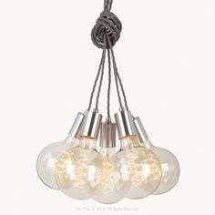 Our Silver Cluster Pendants are made from solid stainless steel, with twisted grey fabric cable electrical cord. The cluster of five pendants can be hung straight down along side each other, draped from the ceiling using a Ceiling Pendant, Pendant Lighting, Ceiling Lights, Electrical Cord, Lighting Store, Grey Fabric, Bulb, Steel, Silver