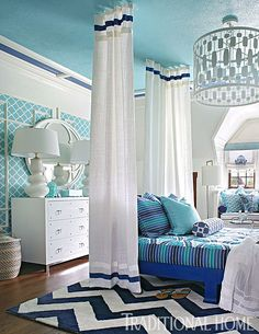 A bold blue-and-white color palette prevails in this showhouse bedroom. - Photo: Peter Rymwid / Design: Rachel Kapner