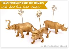"Add ""plastic toy animals"" to your shopping list the next time you make a Dollar Store run.  With some gold spray paint, you can transform them into kitschy-cute place-card holders."