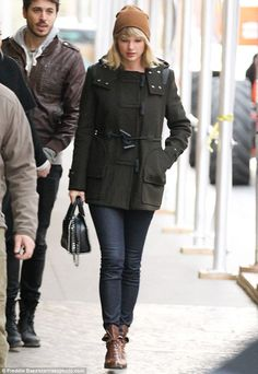 She's a beauty: on Wednesday, Taylor Swift stepped out with friends while bundled up in a ...