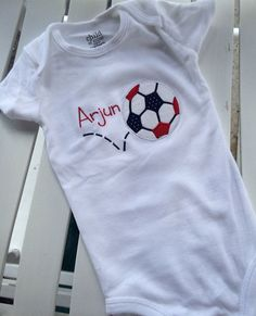 A personal favorite from my Etsy shop https://www.etsy.com/listing/194002636/personalized-soccer-ball-onesie-red
