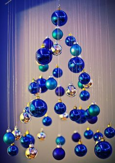 But if you truly want to stand out, we'd suggest you go for a blue Christmas tree this year. we've gathered a list of blue Christmas tree decoration ideas. Blue Christmas Decor, Hanging Christmas Tree, Xmas Tree, Winter Christmas, All Things Christmas, Christmas Crafts, Christmas Ornaments, Modern Christmas, Fish Ornaments