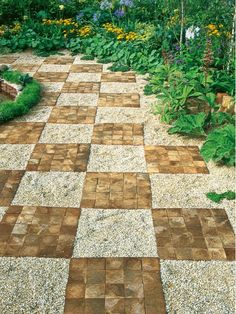 Gravel and Brick Form Checkerboard Pavement Design - Home and Garden Design