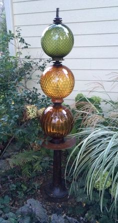 Repurposed garden art created using vintage lamps, discarded metal, and found objects. Glass Garden Flowers, Glass Garden Art, Glass Art, Garden Whimsy, Garden Junk, Garden Crafts, Garden Projects, Recycled Garden Art, Garden Totems