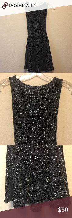 American Apparel Skater Dress Adorable American Apparel sleeveless skater dress. Black with white polka dots on front and back and deep V on the back of dress, showing off your back. New with tag and in excellent condition. American Apparel Dresses Backless