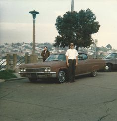 Me in front of my first car that was a 1966 Chevy Caprice and Mr. Sleepy in the back -San Francisco Mission District 1980's