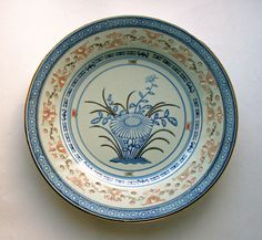 A very pretty vintage decorative plate The pattern consists of a beautiful blue, white and gold floral and geometric design.  The plate is in