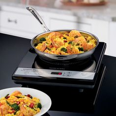 Features:  -Single induction burner.  -Safe, exhaust-free, flame-free cooking.  -Uses up to 70% less energy than conventional cooktops.  -150 minute timer with LED timer display.  -Easy one-touch cont