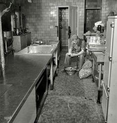 Soldier in kitchen doing his duties