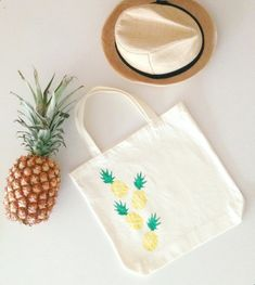 I made a pineapple motif tote bag using a potato as the stamp and fabric paint. Slice two 2-inch pieces of potato: use one for the body and one for the leaves. Carve using a small knife. Dip in paint and stamp (first the body, then the leaves).