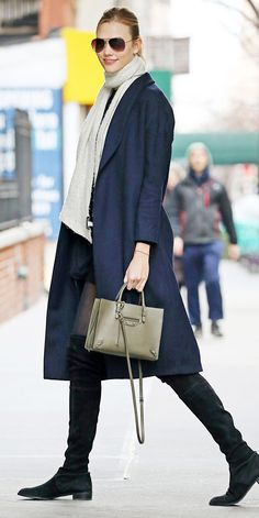 Karlie Kloss fought off frost bite in a perfectly layered look, comprised of over-the-knee boots, a navy topper, and a cozy gray scarf. For finishing touches, the model accessorized with classic aviator sunglasses and an olive green top handle bag.    - from InStyle.com