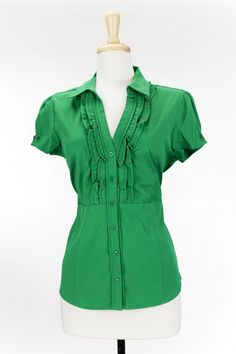 Dressing Your Truth - Type 1 Greener Grass Top     Crafted in vibrant green, this taylored top is cute with a ruffled front. Finished with gathered cap sleeves and elactic strip at back high waist for a flattering fit.        77% Polyester, 30% Nylon      Cap Sleeve      Button Front      V Neck