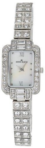 AK Anne Klein Women's Swarovski® Crystal Accented Silver-Tone Watch #108091MPSV Anne Klein. $95.00. Clear Swarovski® crystals on the charms. White genuine Mother-of-pearl dial. Quartz movement. Roman numerals XII, VI, and 10 pearlings. Silver-tone case and bracelet