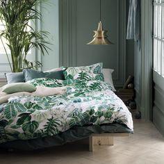 Dormitorio con ropa de cama de H&M Home
